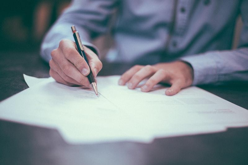 Man signing paper